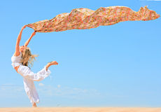 Girl with flying cloth Stock Photos