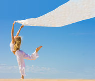 Girl with flying cloth her hands Stock Images