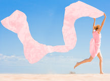 Girl with flying cloth in her hands Royalty Free Stock Image