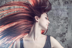 Girl with flying hair Royalty Free Stock Image