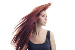 Girl with flying hair isolated over white Royalty Free Stock Image