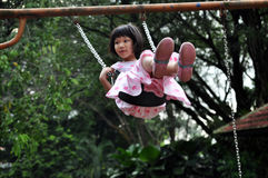 Girl Flying High on Swing Royalty Free Stock Image