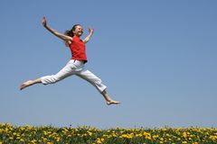 Girl flying in a jump Stock Images