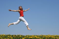 Girl flying in a jump Royalty Free Stock Photography