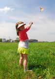 Girl flying kite Stock Photo