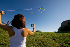 Girl with flying kite Royalty Free Stock Images