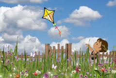 Girl flying a kite in garden Royalty Free Stock Photography
