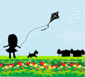 Girl with flying kite. Royalty Free Stock Photography