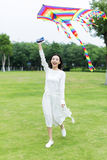 Girl flying a kite in the park Royalty Free Stock Photography