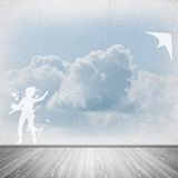 Girl and flying kite Royalty Free Stock Image