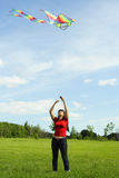 Girl flying kite on summer meadow Royalty Free Stock Photos