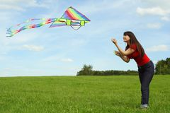 Girl flying kite on summer meadow Royalty Free Stock Images