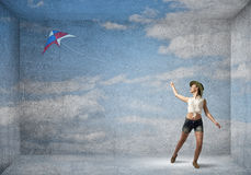 Girl and flying kite Royalty Free Stock Photos