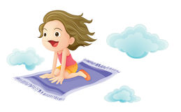 A girl flying on mat Stock Image