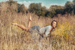 Girl flying over the meadow. Girl flies over the meadow with yellow wildflowers Royalty Free Stock Photography