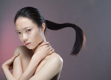 Girl with flying ponytail Royalty Free Stock Image