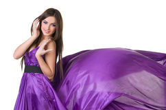 Girl in flying purple dress Stock Photo