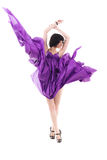Girl in flying purple silk dress Royalty Free Stock Photography