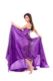 Girl in flying purple silk dress Stock Photography