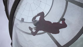 Girl flying trains with a parachute jump. Extreme parachuting. Simulator flying with a parachute stock footage