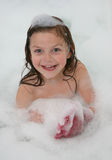 Girl in foam Royalty Free Stock Photos
