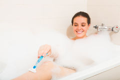 Girl in foam at bathtub Royalty Free Stock Image
