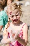 Girl in foam party Stock Photo
