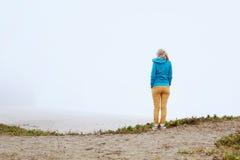 Girl on foggy beach Stock Photo