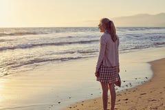 Girl on foggy beach Stock Photography