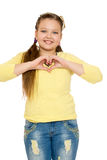 The girl folded hands heart Royalty Free Stock Photo