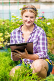 Girl with a folder analyzes the growth and development of plants Stock Photos
