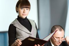 Girl with folder and men stock images