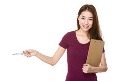 Girl with folder and pen show out Stock Image