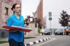 Girl with folders for papers and coffee Royalty Free Stock Images