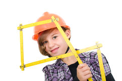 Girl with folding ruler. Girl as a craftsman with a folding rule Stock Photography