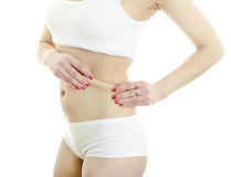 Girl folding skin on her waist. Royalty Free Stock Photo