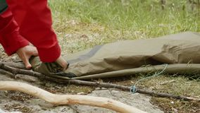 Girl folds tent in Norway stock video footage