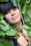 The girl in foliage. Blindly Royalty Free Stock Photos