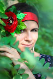Girl in foliage Royalty Free Stock Images