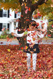 Girl and Folige. A girl is shrowing the foliage leaves in the air Stock Photo