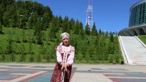 Girl in folk costume dancing stock footage