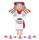 Girl in folk costume wonders with wreath Royalty Free Stock Photography