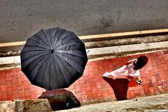 Girl followed by umbrella Royalty Free Stock Images