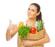 Girl with food bag. Isolated Stock Photos