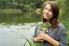 Girl fooling around with flowers in their hands Stock Image