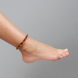 Girl foot isolated on the grey background Stock Image