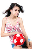 Girl with football Royalty Free Stock Photography
