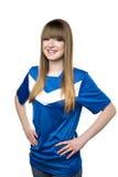 Girl in football shirt Stock Image