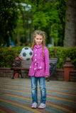 Girl with football Stock Images
