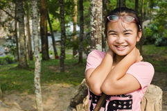 Girl in the forest. Young girl smiled happily in the forest Royalty Free Stock Photography